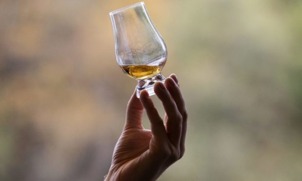 """File photo dated 18/10/19 of whisky in a glass. A union has started balloting whisky workers at Chivas Brothers over strike action in response to """"corporate greed"""" attempts to impose a pay freeze. GMB Scotland said the Chivas parent company Pernod Ricard had awarded pay rises to its workers in France earlier this year. Issue date: Monday April 19, 2021. PA Photo. See PA story INDUSTRY Chivas. Photo credit should read: Jane Barlow/PA Wire"""