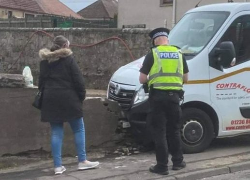 The van crashed into a wall on a Lochgelly street after striking a pensioner.