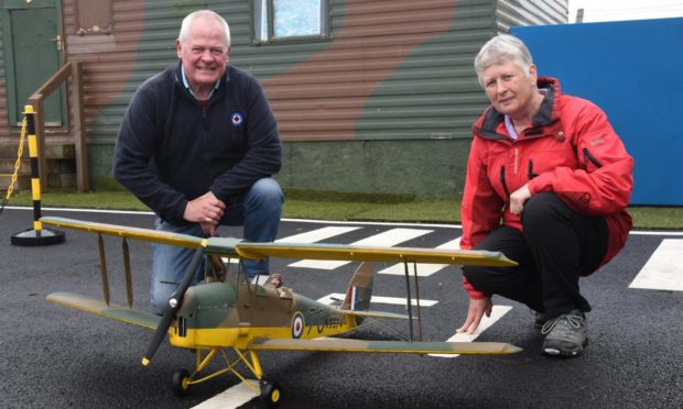 MAHSC chairman Stuart Archibald and Fiona Dawson with the model aircraft.