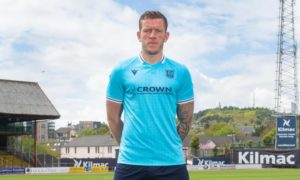 Lee Ashcroft models Dundee's eye-catching new away kit at Dens Park.