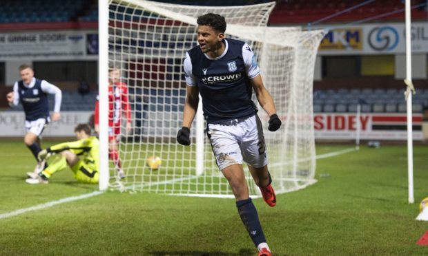 Osman Sow celebrates his goal for Dundee against Dunfermline.