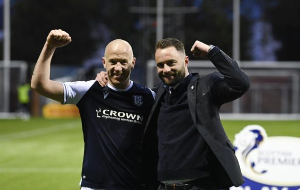 Charlie Adam and manager James McPake celebrate at Rugby Park.