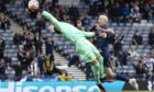 Czech Republic goalkeeper Tomas Vaclik claws the ball away under pressure from Lyndon Dykes. Picture by SNS.