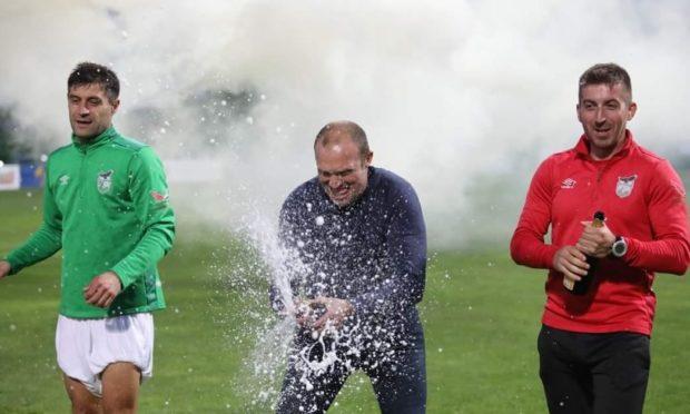 Feeney celebrates title