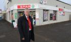 Cllr Charlie Malone outside Spar Menzieshill.