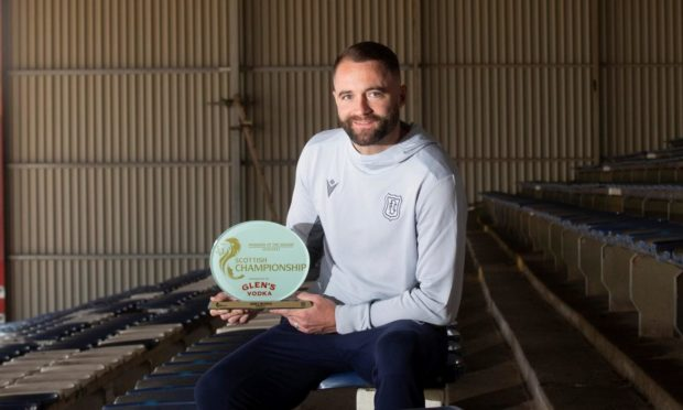 Dundee boss James McPake with the award.