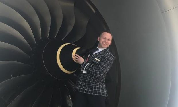 Ross Greig during his time as an airline cabin crew member.