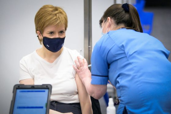 First Minister of Scotland Nicola Sturgeon receiving the first shot of the Astra Zeneca vaccine.