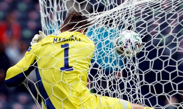David Marshall crashes into the back of the net.