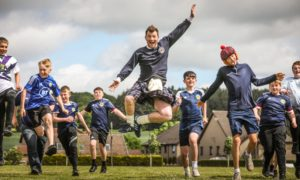 Pupils and staff at Baldragon Academy wore Scotland tops for the match.