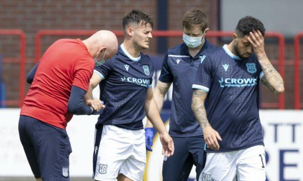 Dundee's Danny Mullen (centre) receives treatment against West Ham.