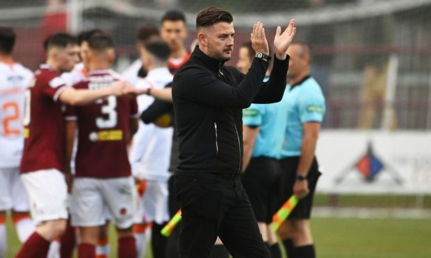 Dundee United boss Tam Courts salutes the travelling support after his first match in charge ends in a 1-0 win at Kelty Hearts.