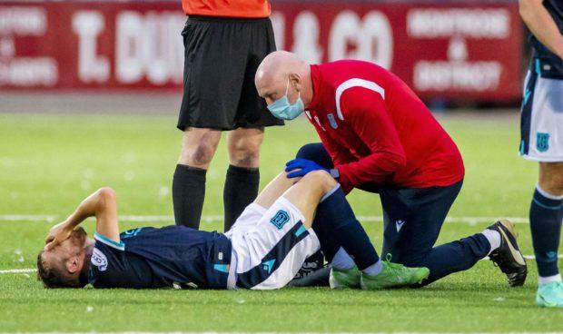 Paul McMullan receives treatment.