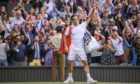 Roger Federer waves to the crowd as he leaves the court after being defeated by Hubert Hurkacz.
