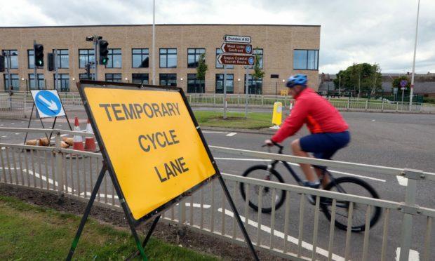 A man cycling in Arbroath