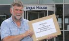 Inveresk Community Council chairman Gus Leighton with the Inglis Court petition. Pic: Gareth Jennings/DCT Media