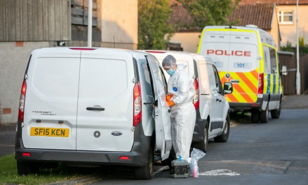 Forensic and police officers in Glenrothes on Monday evening.