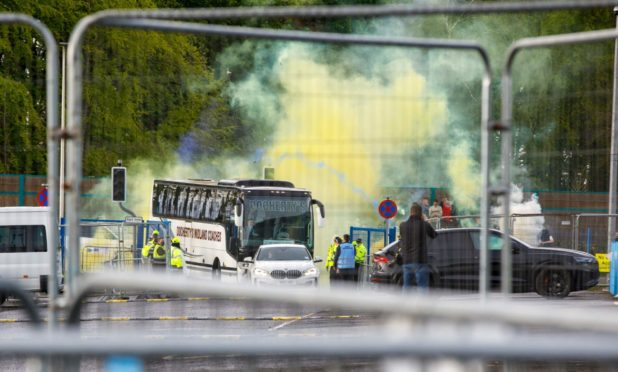 The St Johnstone team arrives at McDiarmid Park with the Scottish Cup.