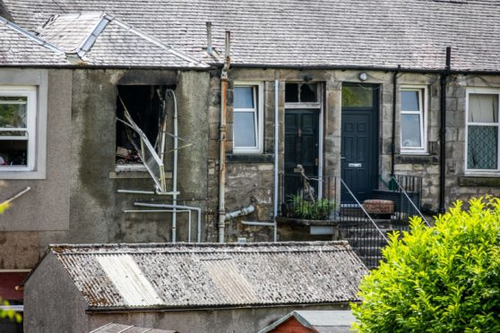 The aftermath of the explosion in Dewar Street.