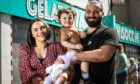 Mum Emma, toddler Valentino and Visocchi's Café owner Marco with new born baby Azzurra.