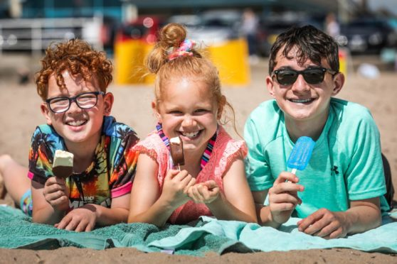 Myles, 10, Mila, 7 and Calvin, 13, Graves enjoy ice cream on the beach at Broughty Ferry.