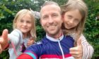 Nathan Grove with daughters Abigail, 7, and Madeline, 9. Angus. Supplied by Nathan Grove.