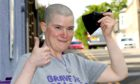 Sarah Anderson braved the shave to raise money for Macmillan Cancer Support. Pic: Gareth Jennings/DCT Media.