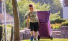Declan Crosbie on purple bin duty near his Arbroath home. Pic: Steve MacDougall DCT Media.