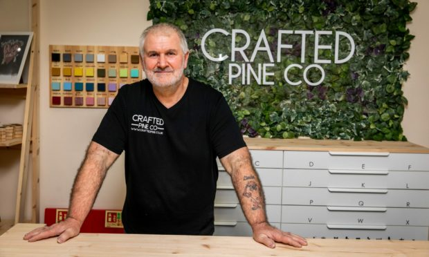 Don Tait of Crafted Pine Co inside the premises at Overgate Shopping Centre.