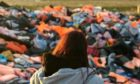 Suzanne Milne, looking over a graveyard of lifejackets at Moria Camp on the Greek island of Lesvos.