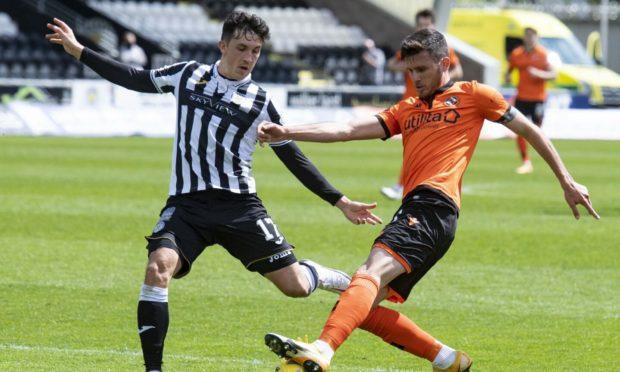Dundee United's Adrian Sporle is closed down by St Mirren's Jamie McGrath during a Premiership clash last season.