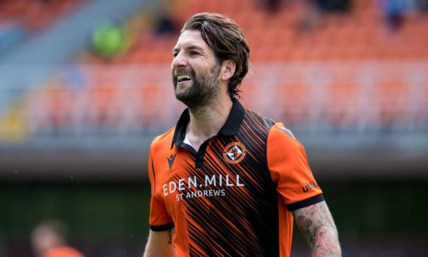 Charlie Mulgrew celebrates with the Dundee United fans after the win over Rangers