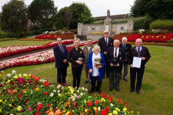 Carnoustie Legion chairman Davie Paton and others involved in looking after the award-winning town memorial. Pic: Paul Reid.