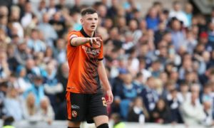 Dundee United's Kerr Smith made his first appearance in the Dundee derby, aged 16.