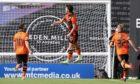 Dundee United's Ian Harkes celebrates making it 1-0.