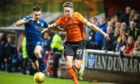 Dundee's Cammy Kerr and United's Louis Appere compete for possession in a 2019 derby.