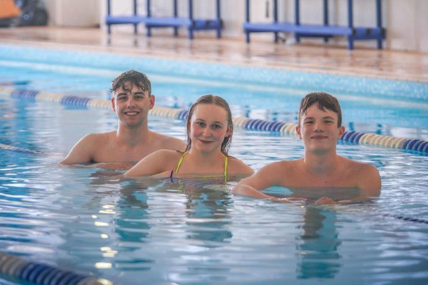 Strathallan School pupils Owen Carroll, Elise Cosens and Evan Davidson have been chosen to represent Scotland's national swimming team.