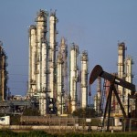 Oil extends losses as higher US output outlook counters curbs