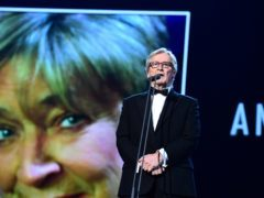 William Roache pays tribute to Anne Kirkbride on stage during the 2015 National Television Awards (Ian West/PA)