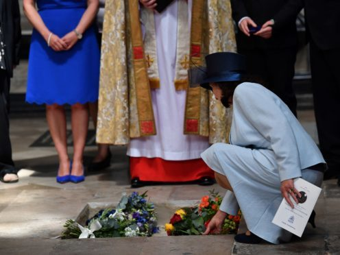 Jane Hawking lays flowers as the ashes of Professor Stephen Hawking are laid to rest during his memorial service at Westminster Abbey (Ben Stansall/PA)