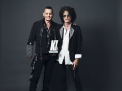 Undated handout photo issued by Kerrang! Magazine of Johnny Depp, as he presents Joe Perry with a Kerrang! Icon Award at Islington Assembly Hall, London (Kerrang! Magazine)