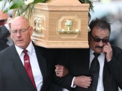 Paul Elliott carries the coffin of his brother Barry Chuckle (real name Barry Elliott) at the New York Stadium, Rotherham (Danny Lawson/PA)