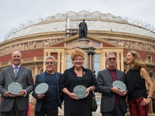 From left to right, Randolph Churchill, Roger Daltrey, Eve Ferret of Chelsea Arts Club, Eric Clapton and Katie Derham outside the Royal Albert Hall, London (Dominic Lipinski/PA)