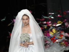 Gigi Hadid wears mini puffball wedding dress at star-studded Moschino show (Antonio Calanni/AP/PA)