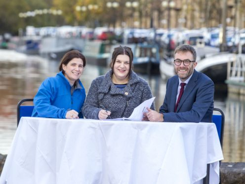 Representatives at the launch of the 'smart canal' scheme in Glasgow (Peter Devlin/PA)