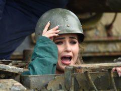 Love Island's Georgia Steel tries her hand at driving a tank (Joe Giddens/PA)