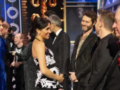 The Duchess of Sussex meets Howard Donald and Gary Barlow on stage at the Royal Variety Performance (Ian Vogler/Daily Mirror)
