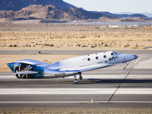 Virgin Spaceship Unity touching down after flying freely for the first time in the Mojave Desert, USA (Virgin Galactic/PA)