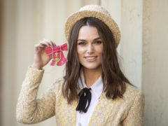 Keira Knightley with her OBE outside Buckingham Palace (Victoria Jones/PA)