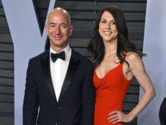 Jeff and MacKenzie Bezos (Agostini/Invision/AP, File)